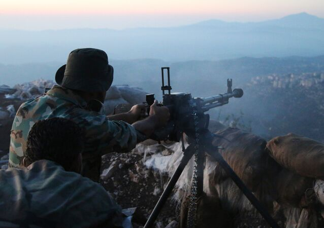 Syrian army personnel fire a machine gun in Latakia province, about 12 miles from the border with Turkey, Syria (File)