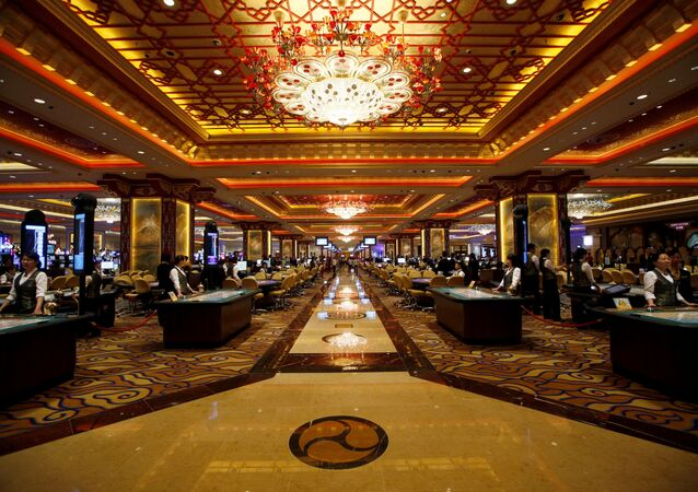 Casino workers stand at gaming tables inside the Sands' newest integrated resort, Sands Cotai Central, in Macau  (File)