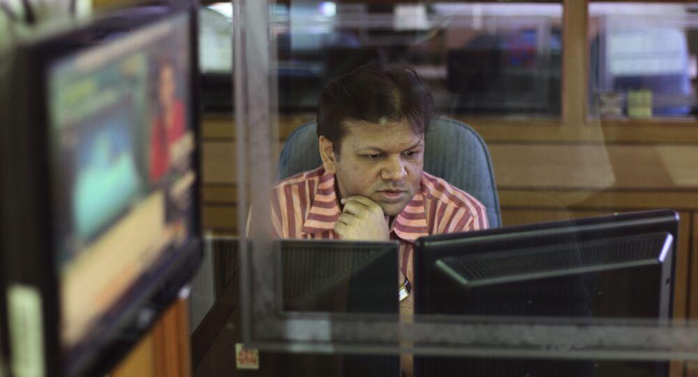 An Indian stockbroker looks at a trading terminal at a stock brokerage in Mumbai, India, Thursday, Aug. 22, 2013