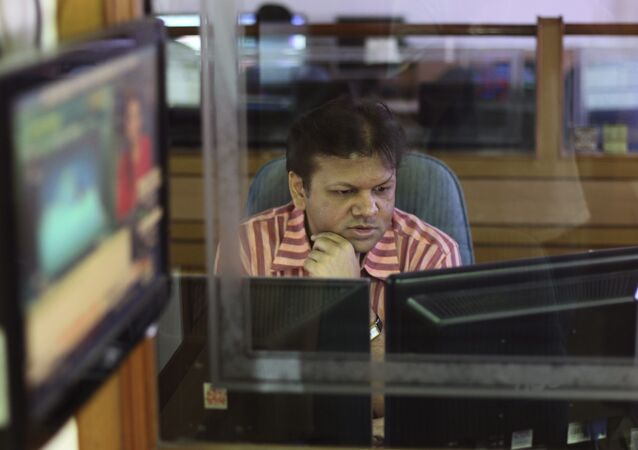 An Indian stockbroker looks at a trading terminal at a stock brokerage in Mumbai, India, Thursday, Aug. 22, 2013