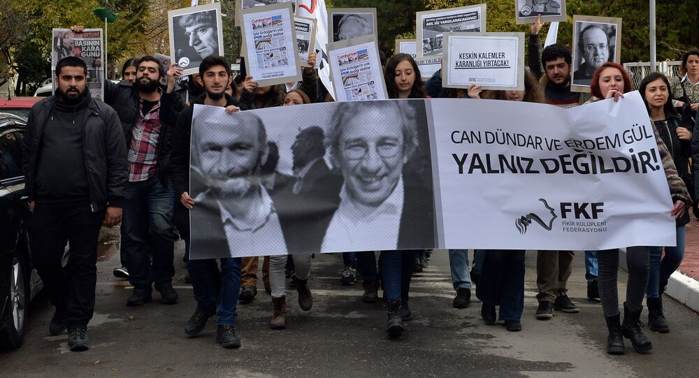 People demonstrate against the jailing of opposition Cumhuriyet newspaper's editor-in-chief Can Dundar and Ankara representative Erdem Gul, in Ankara, Turkey, Friday, Nov. 27, 2015