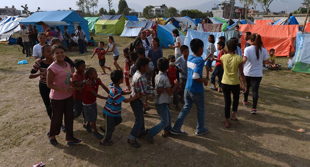 Nepalese children play at a relief camp for survivors of the Nepal earthquake in Kathmandu on May 26, 2015