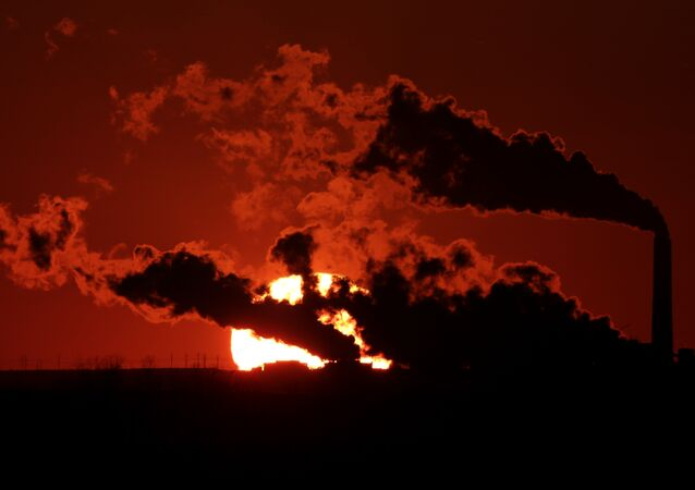 In this March 8, 2014, file photo steam from the Jeffrey Energy Center coal-fired power plant is silhouetted against the setting sun near St. Marys, Kan.