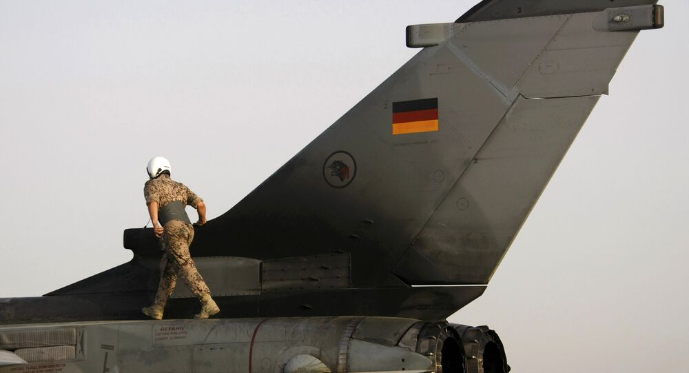 File photo of a German soldier walking on a Tornado fighter jet before a reconnaissance flight from the German camp in Mazar-e-Sharif August 28, 2009