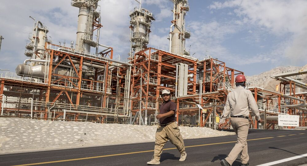 Iranian workers walk at a unit of South Pars Gas field in Asalouyeh Seaport, north of Persian Gulf, Iran November 19, 2015