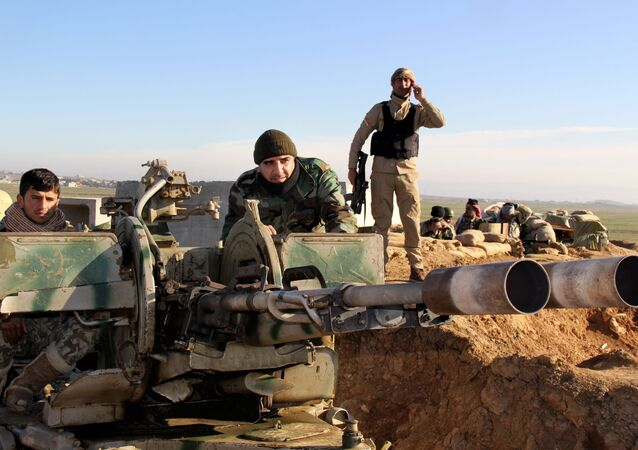 Kurdish peshmerga forces prepare their positions on the front line for battle against Islamic State group positions in northern Iraq.