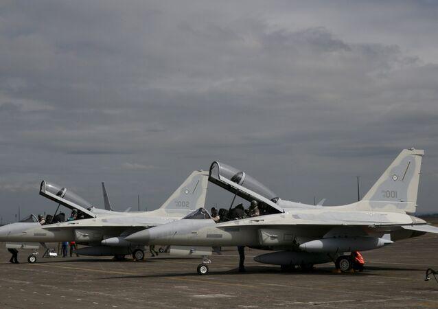 Pilots arrive with two FA-50PH aircraft at Clark Air Base at Angeles city, Pampanga province, north of Manila on November 28, 2015.