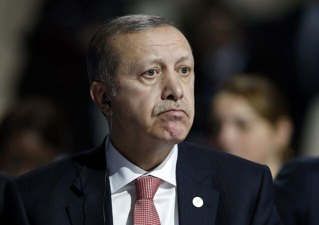 Turkey's President Recep Tayyip Erdogan listens to statements at the COP21, United Nations Climate Change Conference, in Le Bourget, outside Paris, Monday, Nov. 30, 2015