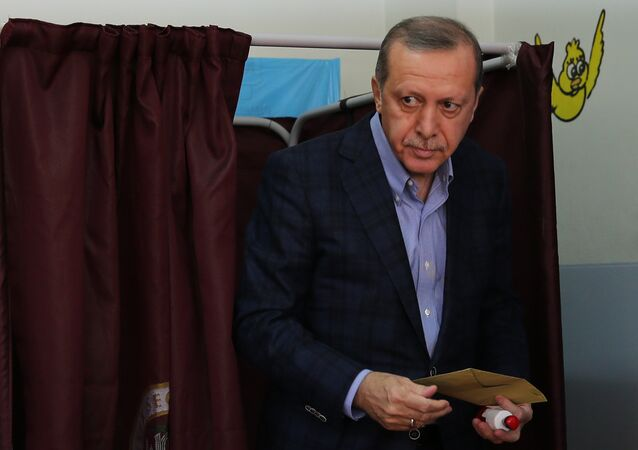 Turkey's President Recep Tayyip Erdogan leaves a voting booth as he prepares to cast his vote at a polling station, in Istanbul, Sunday, Nov. 1, 2015