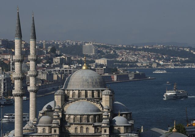 The New Mosque is backdropped by Istanbul's skyline and the Bosporus, Thursday, July 9, 2015