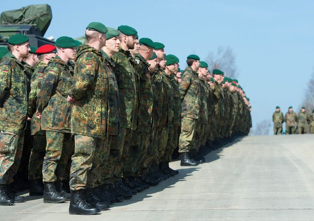 German army soldiers who are members of the Stabilisation forces line up at the barracks Erzgebirgskaserne in Marienberg, eastern Germany, on April 10, 2015, during a military exercise Noble Jump that is part of Nato Response Force