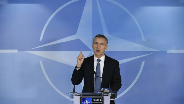 NATO Secretary General Jens Stoltenberg speaks during a press conference before a Foreign Affairs meeting at the NATO headquarters in Brussels on December 01, 2015 - Sputnik International