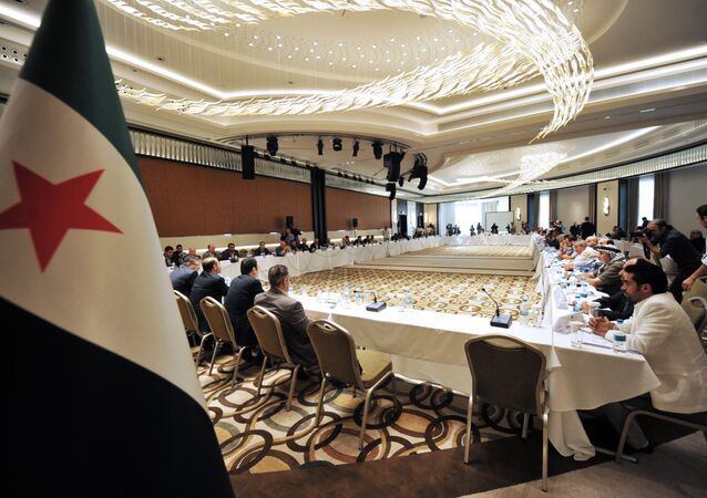Members of Syrian National coalition (SNC) attend a meeting of the National Coalition of Syrian Revolution and Opposition forces on September 13, 2013, in Istanbul