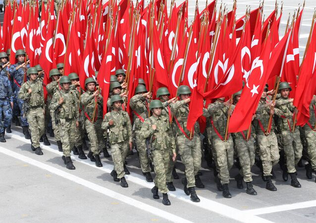 Troops parade with Turkish flag on August 30, 2013 in Ankara during celebrations for the 91st anniversary of Victory Day, with ceremonies held at Ataturk's Mausoleum known as Anitkabir in Ankara, Turkey