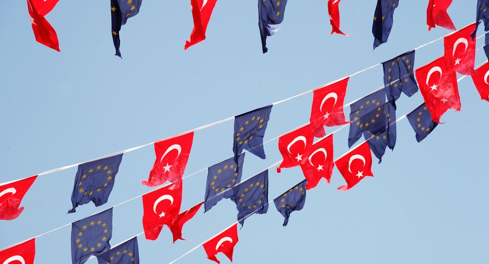 Turkish and European Union flags fly together at Taksim Square on May 24, 2013, in Istanbul