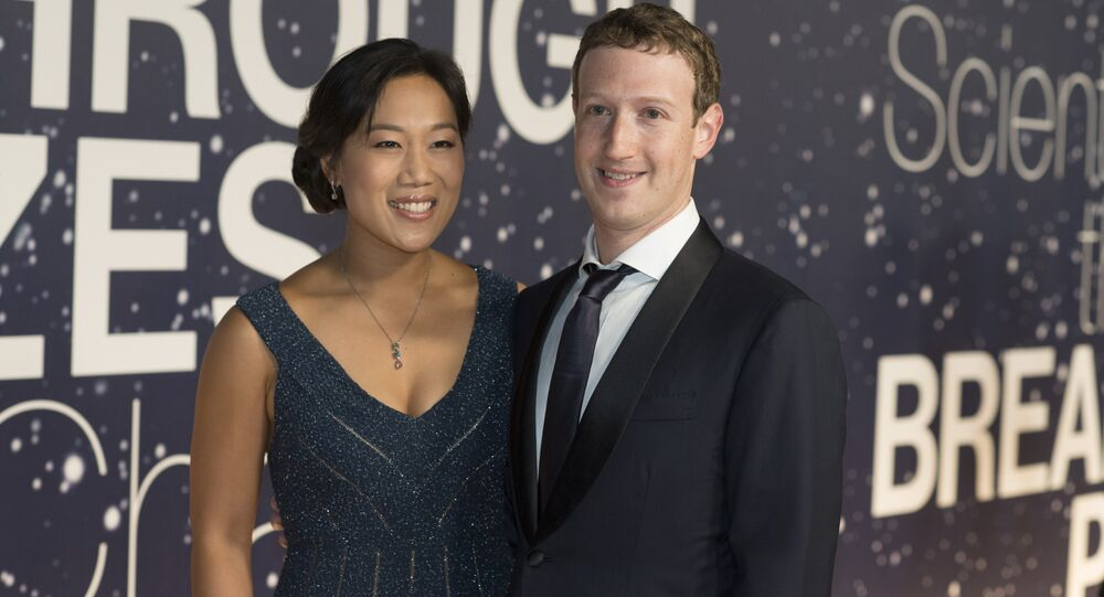 Priscilla Chan and Mark Zuckerberg arrive at the 2nd Annual Breakthrough Prize Award Ceremony at the NASA Ames Research Center in Mountain View, Calif.