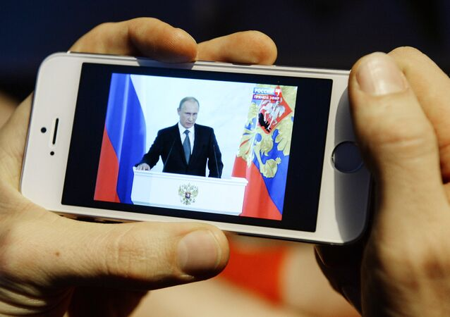 Novosibirsk resident watches the broadcast of Vladimir Putin's annual Presidential Address to Federal Assembly