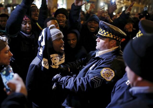 Demonstrators confront police officers during a protest in reaction to the fatal shooting of Laquan McDonald in Chicago, Illinois, November 27, 2015