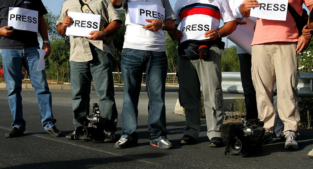 Greek Cypriot journalists and cameramen stand at the Aghios Dometios checkpoint crossing next of UN buffer zone during a peaceful protest in divided capital of Nicosia (File)