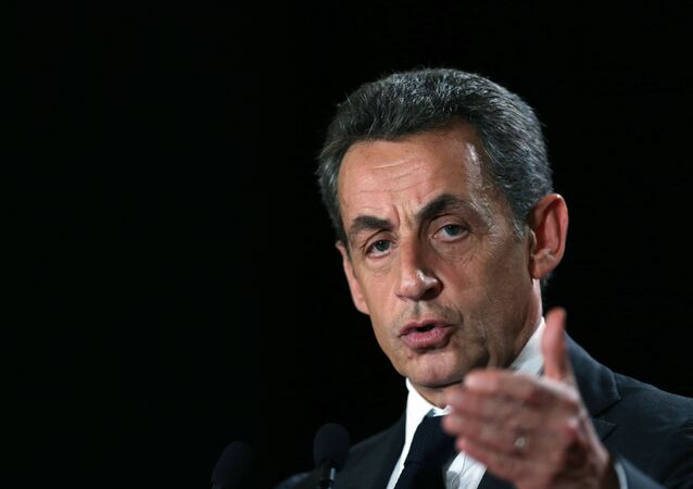 French right-wing opposition Les Republicains (LR) party President Nicolas Sarkozy gestures as he delivers a speech during a campaign rally in support of candidate for the upcoming regional elections in the Normandy region, Herve Morin, on November 30, 2015 in Rouen, northwestern France