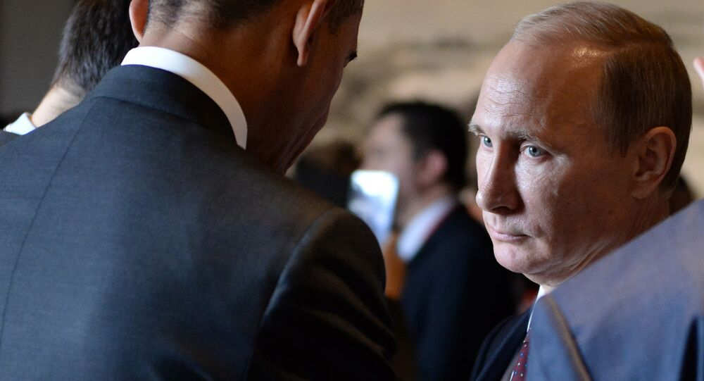 Russian President Vladimir Putin (R) speaks with US President Barack Obama (L) before the Asia-Pacific Economic Cooperation (APEC) Summit plenary session at the International Convention Center in Beijing on November 11, 2014