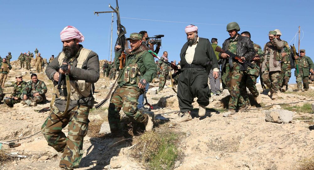 Members of the Kurdish peshmerga forces gather in the town of Sinjar, Iraq. File photo