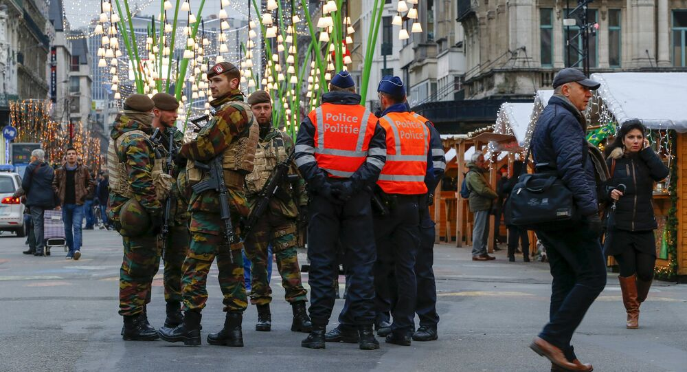 Belgian soldiers and police officers stand guard at Winter Wonders, a Christmas market in central Brussels, Belgium, November 27, 2015, following tight security measures linked to the fatal attacks in Paris