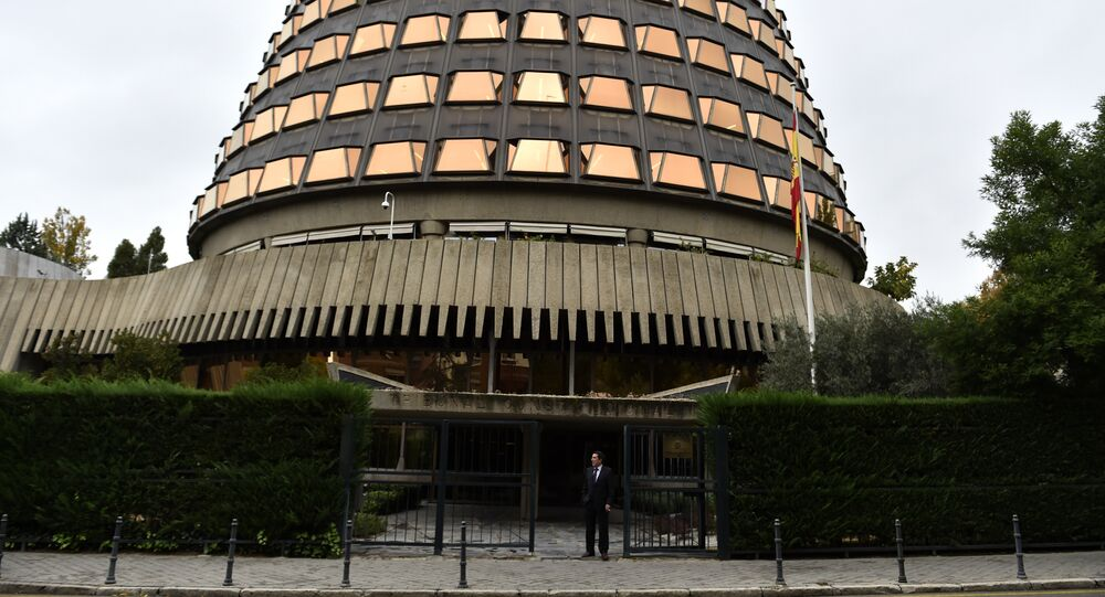 A man stands at the entrance of the Spanish Constitutional court in Madrid on November 4, 2015