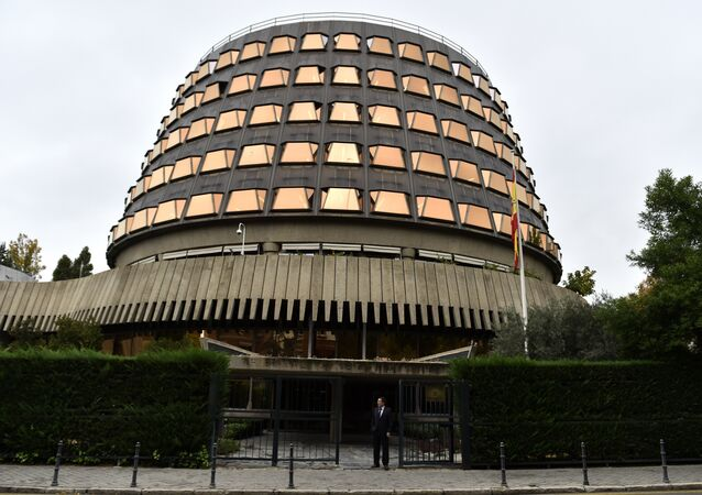 A man stands at the entrance of the Spanish Constitutional court in Madrid.