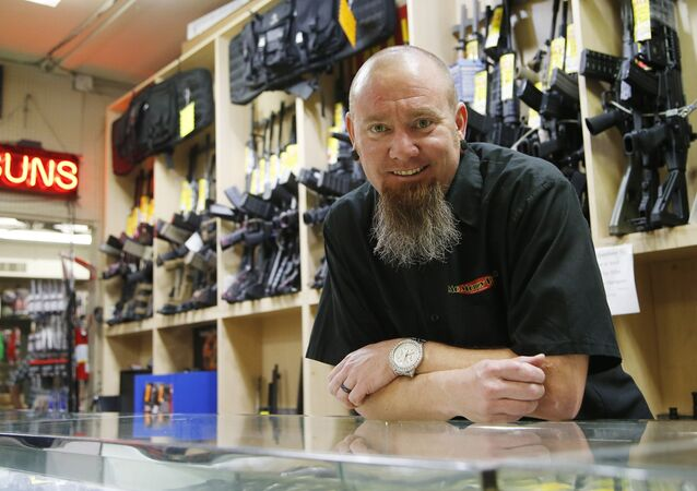 Eric Baker, co-owner of the Mo Money Pawn Shop, poses for a photo at the shop Wednesday, Sept. 23, 2015, in Phoenix.