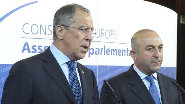 File Photo: Russian Foreign Minister Sergei Lavrov, left, and  Turkish Foreign Minister Mevlut Cavusoglu - Sputnik International