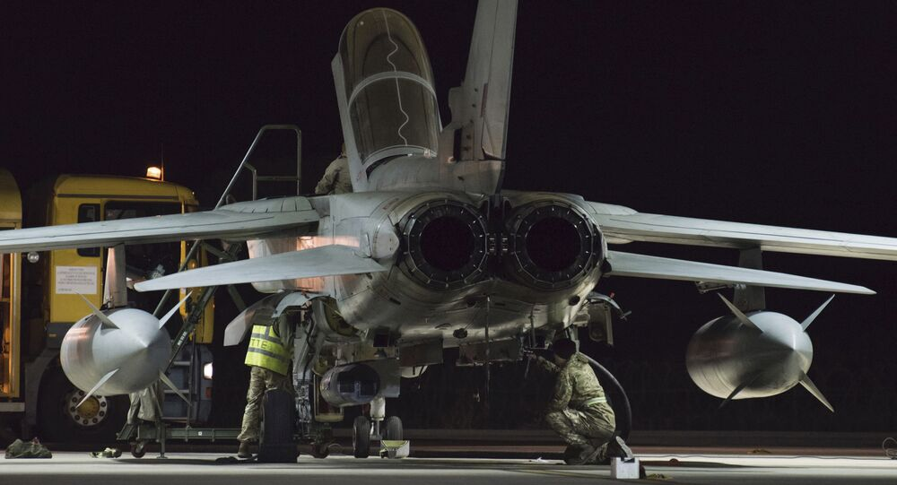 British crew work at a warplane at the RAF Akrotiri, a British air base near costal city of Limassol, Cyprus, early Thursday, Dec. 3, 2015 after an airstrike