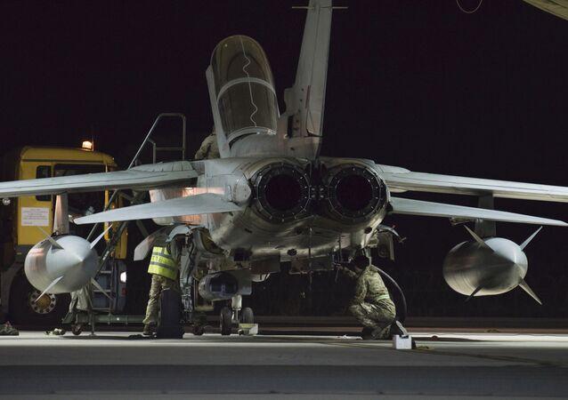 British crew work at a warplane at the RAF Akrotiri, a British air base near costal city of Limassol, Cyprus, early Thursday, Dec. 3, 2015 after an airstrike
