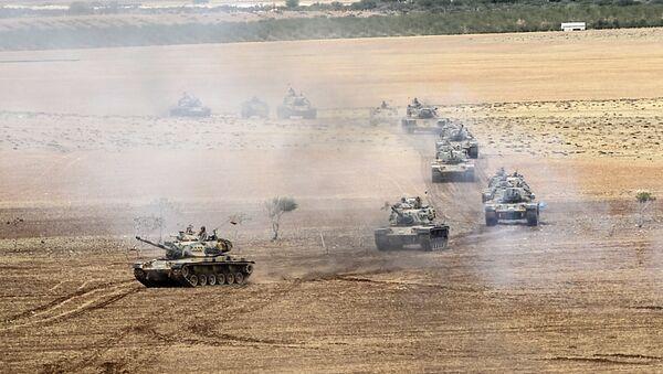 Turkish army tanks take position near the Syrian border in Suruc after three mortars hit the Turkish side. File photo. - Sputnik International
