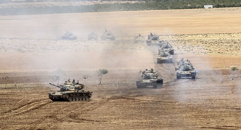 Turkish army tanks take position near the Syrian border in Suruc after three mortars hit the Turkish side. File photo.