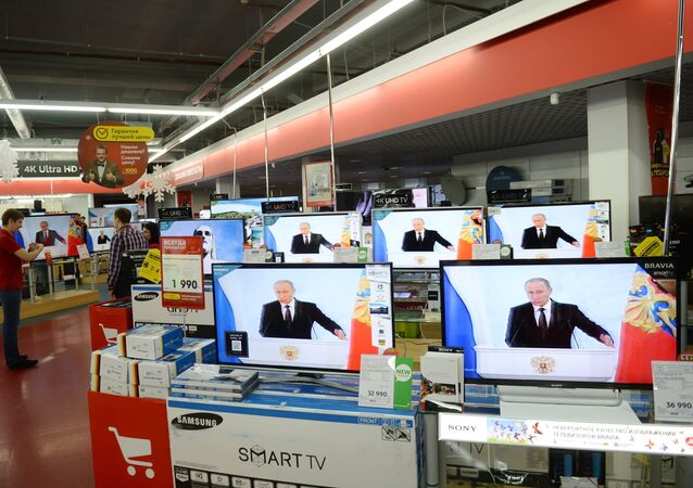The live broadcast of Russian President Vladimir Putin's Presidential Address to the Federal Assembly at an M.Video electronics store in Moscow