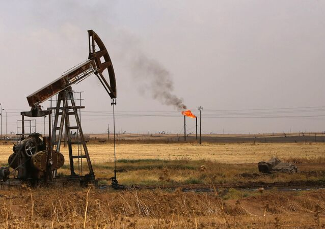Oil well pumps are seen in the Rmeilane oil field in Syria's northerneastern Hasakeh province on July 15, 2015