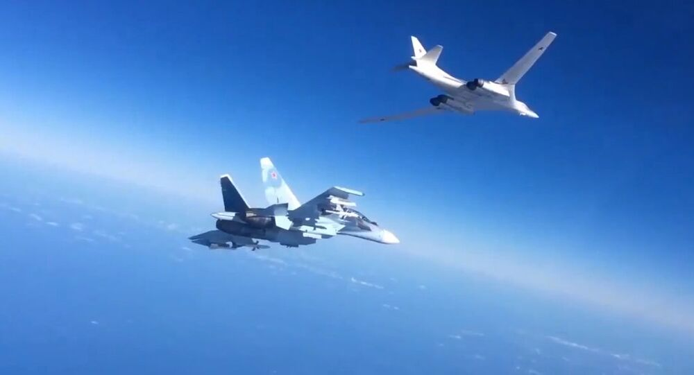 Russian Aerospace Defense Forces' Su-30SM fighter escorts a Tu-160 bomber which fired cruise missiles at Daesh targets in Syria. Still from video published by the Russian Defense Ministry.