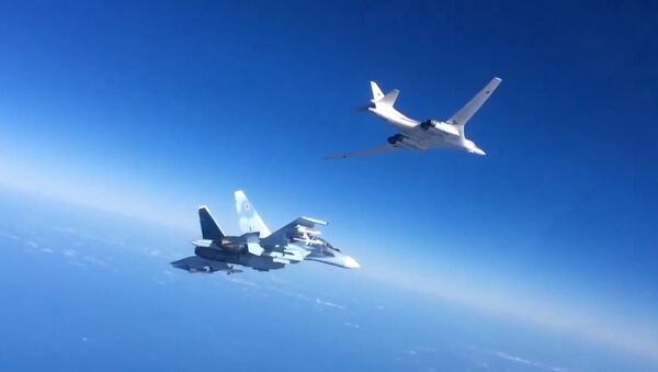 Russian Aerospace Defense Forces' Su-30SM fighter escorts a Tu-160 bomber which fired cruise missiles at Daesh targets in Syria. Still from video published by the Russian Defense Ministry. - Sputnik International