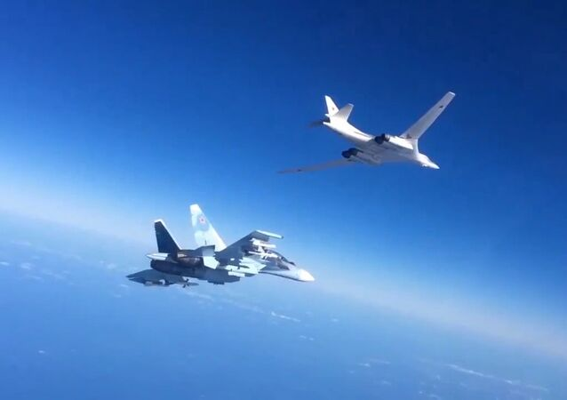 Russian Aerospace Defense Forces' Su-30SM fighter escorts a Tu-160 bomber which fired cruise missiles at ISIS targets in Syria