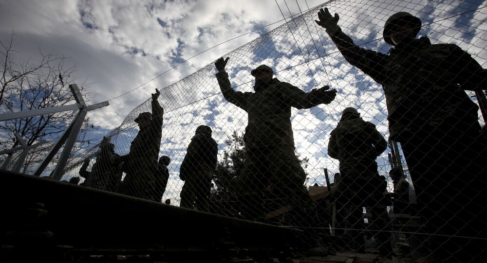 Macedonian Army engineers build a fence on the border line between Macedonia and Greece, near southern Macedonian town of Gevgelija, Sunday, Nov. 29, 2015.
