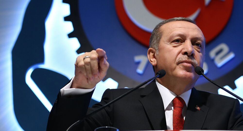 Turkey's President Recep Tayyip Erdogan addresses a labor union meeting in Ankara, Turkey, Thursday, Dec. 3, 2015.