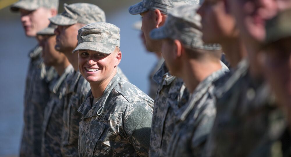 Maj. Lisa Jaster, center, stands in formation with other Rangers during an Army Ranger school graduation ceremony, Friday, Oct. 16, 2015, in Fort Benning, Ga.