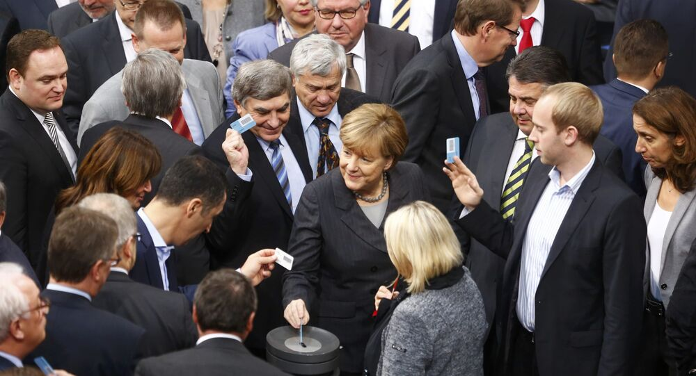 German Chancellor Angela Merkel votes during a session of the Bundestag, the German lower house of parliament, in Berlin, Germany