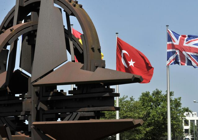 A Turkish and an Union Jack flags are pictured at the NATO Headquarters in Brussels
