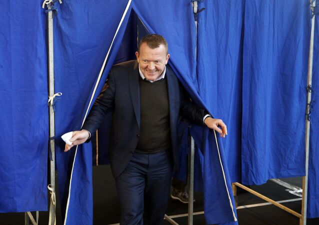 Danish Prime Minister Lars Loekke Rasmussen leaves the voting booth, Thursday Dec. 3. 2015 at a nschool in Copenhagen, Denmark Thursday Dec. 3. 2015.