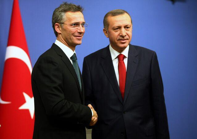 Jens Stoltenberg shakes hands with Recep Tayyip Erdogan