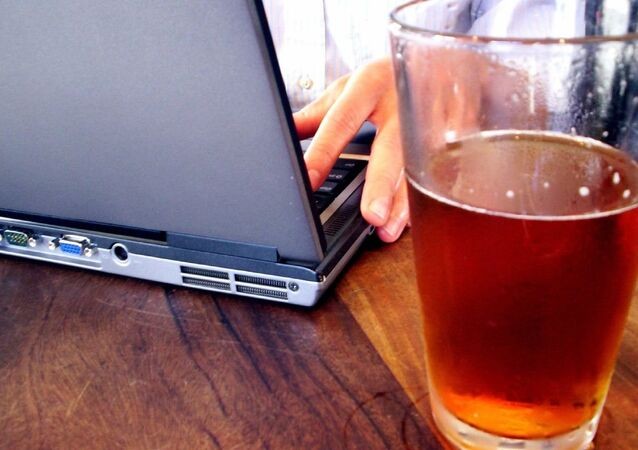 A laptop and a glass of beer
