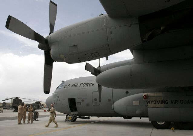 U.S. soldiers are seen near a U.S. air force plane on the runway at the main U.S. air base in Bagram, Afghanistan. (File)