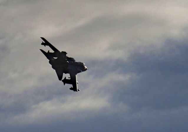 A British Tornado warplane flies over the RAF Akrotiri, a British air base near costal city of Limassol, Cyprus, Thursday, Dec. 3, 2015, after arriving from an airstrike against Islamic State group targets in Syria